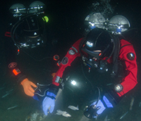 GUE Instructor Steven Millington and GUE Diver Dennis Lawson during an underwater cleanup project - Los Angeles